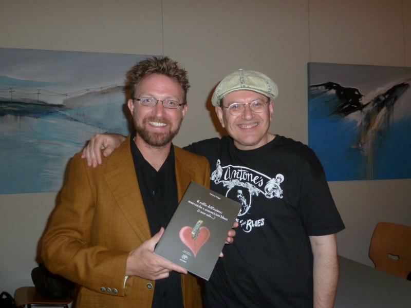 Billy Gibson and Fabrizio Poggi with his book