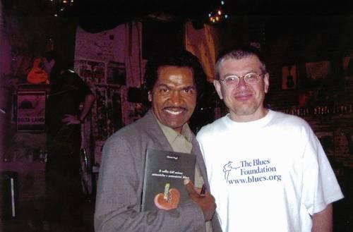 Bobby Rush and Fabrizio Poggi with his book