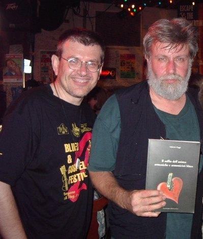 Fabrizio Poggi and Paul Oscher with his book