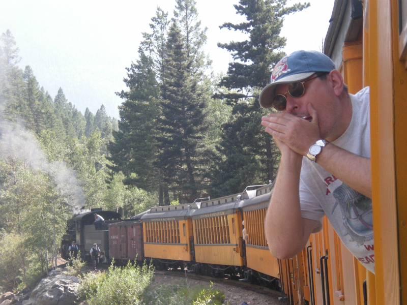 Fabrizio Poggi blowin\' his blues away on a train in Colorado