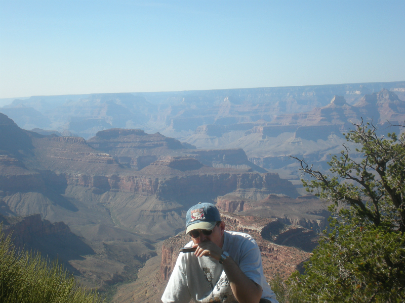 Fabrizio Poggi plays harmonica at the Grand Canyon