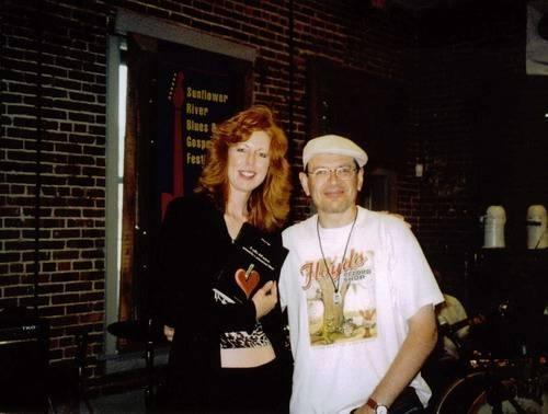 Geneva Red and Fabrizio Poggi with his book