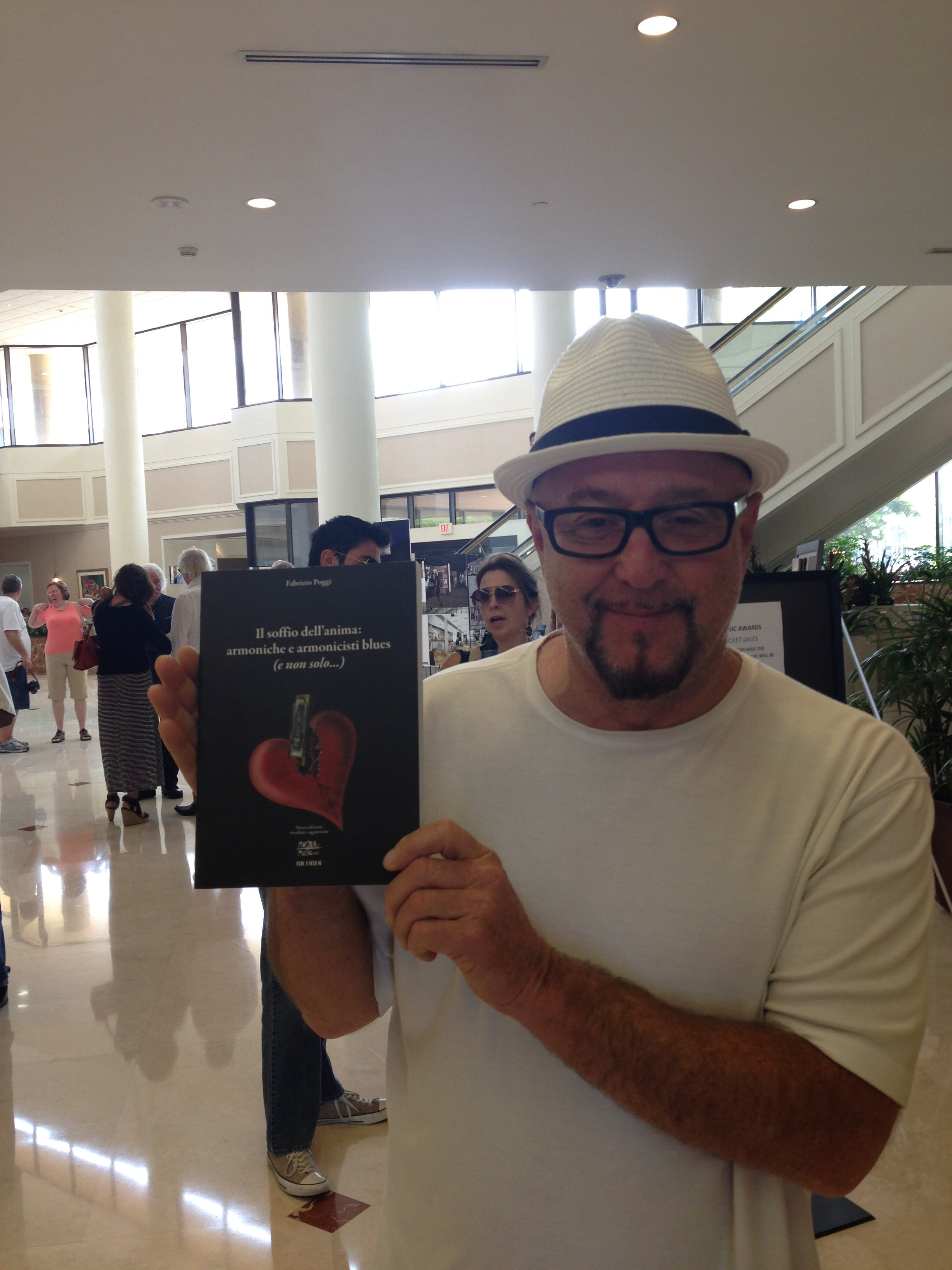KIM WILSON with FABRIZIO POGGI\'S BOOK