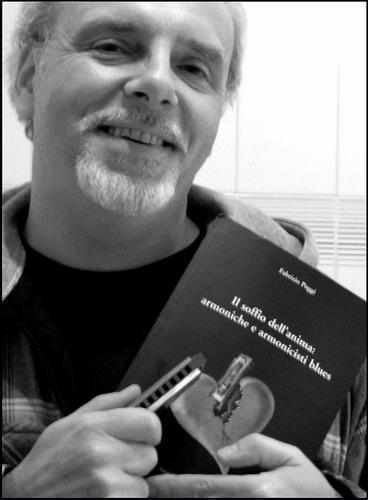 JJ Milteau with Fabrizio Poggi\'s book