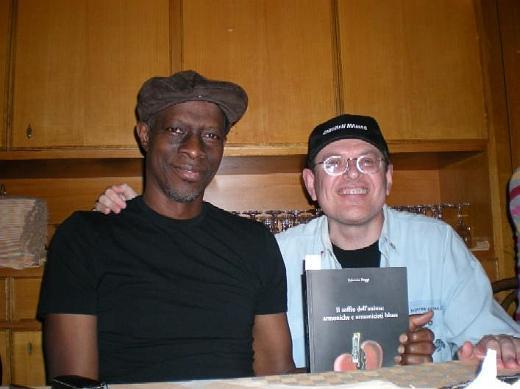 Keb Mo\' and Fabrizio Poggi with his book