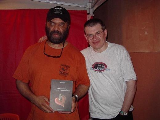 Otis Taylor and Fabrizio Poggi with his book