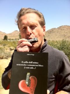 John \'Juke\' Logan with Fabrizio Poggi\'s book