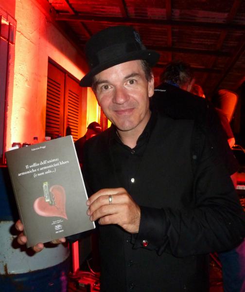 Paul Reddick with Fabrizio Poggi\'s book